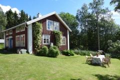 gårdshuset med solig uteplats i Höga Kusten